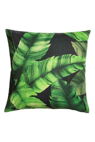 How to style your home on a budget - H&M Home leaf print cushion cover.